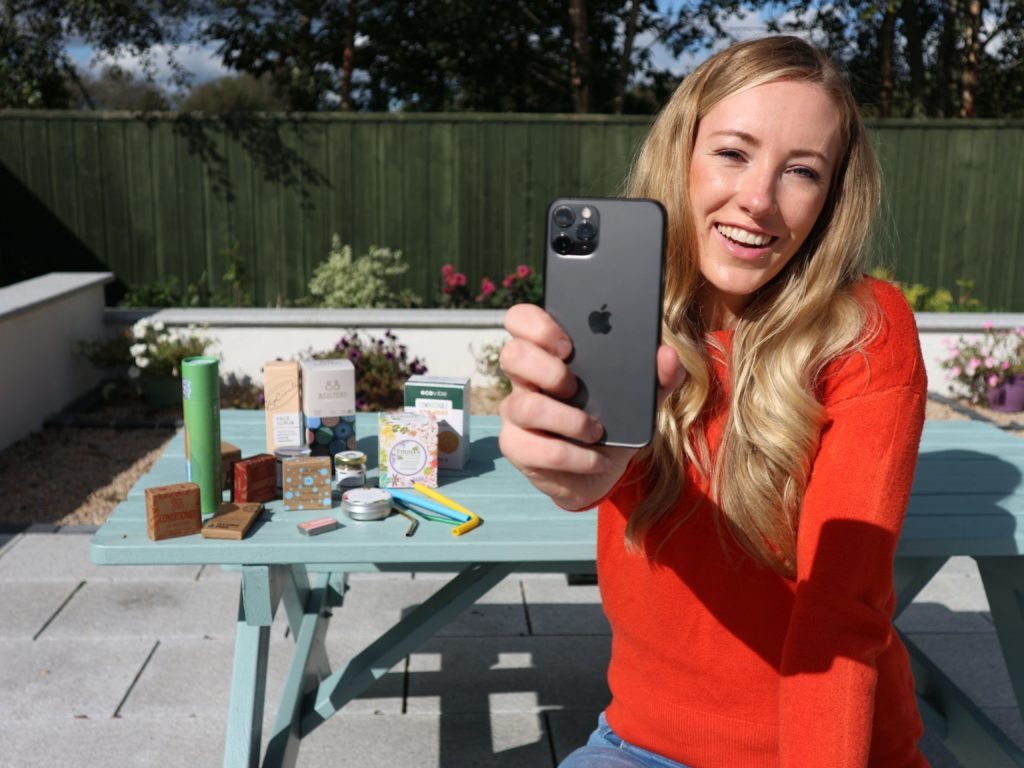 Fiona, Founder of Green Outlook snaps some Green Outlook products with her refurbished iPhone 11 Pro from Swappie